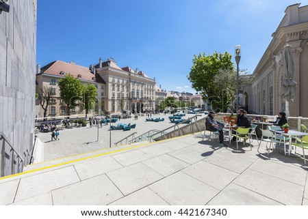 VIENNA, AUSTRIA - APRIL 29, 2016: Many people enjoy a sunny afternoon at the Museumsquartier in Vienna. It is the eighth largest cultural area in the world.
