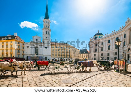 VIENNA, AUSTRIA - APRIL 21, 2016: Michaelerplatz with traditional  fiacres in bright sunny day - stock photo