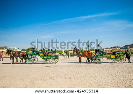 VIENNA, AUSTRIA - APRIL 23, 2016: Old-fashioned fiacres in Schonbrunn Palace - stock photo