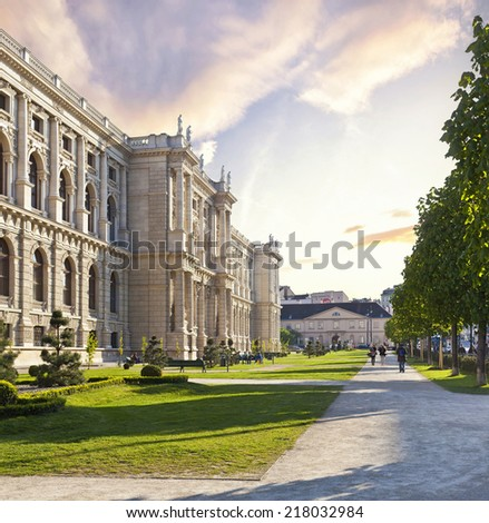 VIENNA, AUSTRIA - APRIL 17: People enjoy a walk in the park beside the historic building Museum of Art History on April 17, 2014 in Vienna. Build 1891 during Austrian-Hungarian Monarchy. - stock photo