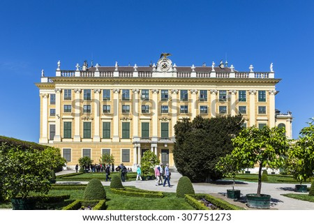 VIENNA, AUSTRIA - APRIL 24, 2015: people visit the prince garden in the  Royal palace in Vienna.  The former imperial summer residence is a UNESCO World Heritage site.