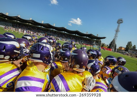 VIENNA, AUSTRIA - APRIL 27, 2014: The team of the Vienna Vikings in the huddle before the game. - stock photo