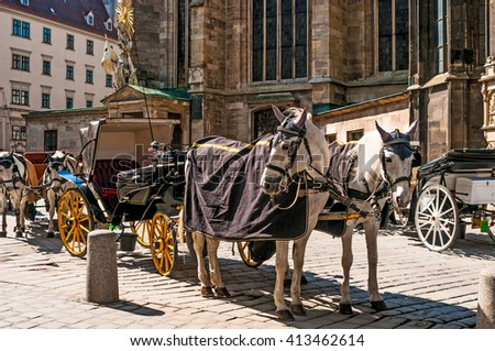 VIENNA, AUSTRIA - APRIL 21, 2016: Traditional old-fashioned fiacres at Stephansplatz of Vienna, Austria. Stephansplatz is the most popular square in the city  - stock photo