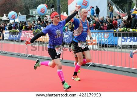VIENNA, AUSTRIA - APRIL 10, 2016: Two runners finish the Vienna City Marathon , April 10, 2016 in Vienna, Austria. - stock photo