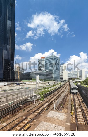 VIENNA, AUSTRIA - APRIL 30, 2014: Vienna metro at the Danube City with the UNO complexe in the background and part of the the new DC-Tower - the tallest skyscraper in Austria - stock photo