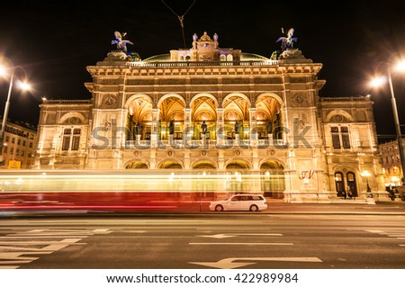 VIENNA, AUSTRIA - APRIL 23, 2016: View of Vienna State Opera House (Staatsoper) and moving tram by night - stock photo