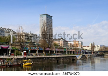 VIENNA, AUSTRIA - April 13, 2015: View over Donaukanal (Danube canal) to Ringturm (Ring Tower). Opened in 1955, the Ringturm was Vienna's first office skyscraper. - stock photo