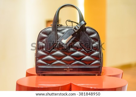VIENNA, AUSTRIA - AUGUST 10, 2015: Luxurious Woman Clothing And Accessories For Sale In Store Window Display. - stock photo