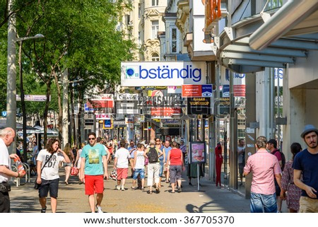 VIENNA, AUSTRIA - AUGUST 08, 2015: People Shopping On Mariahilferstrasse The Largest And One Of The Most Popular Shopping Streets Of Vienna.