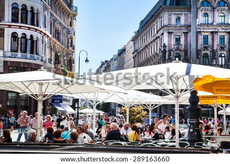 VIENNA, AUSTRIA - 26 AUGUST: people taking lunch at a terrace in center of Vienna, Austria on 26 AUGUST 2012 - stock photo