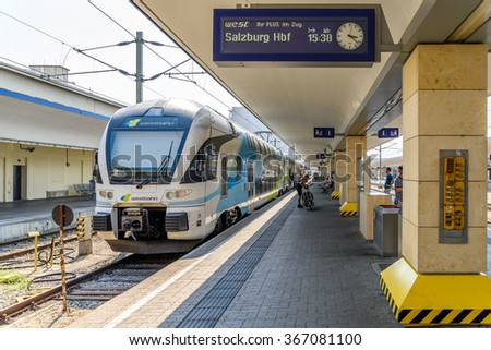 VIENNA, AUSTRIA - AUGUST 08, 2015: People Waiting For Train In Wien Mitte Station The Major Hub For S-Bahn Suburban Trains, U-Bahn Trains And The City Airport Train (CAT). - stock photo
