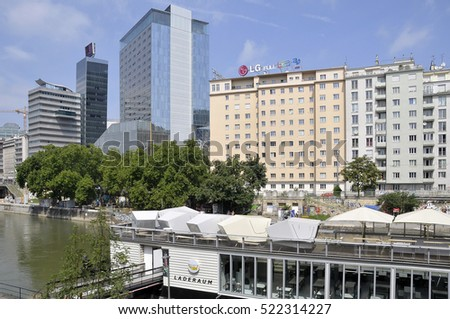 VIENNA, AUSTRIA - AUGUST 07, 2011: Spa and buildings near the river, in the center of the city