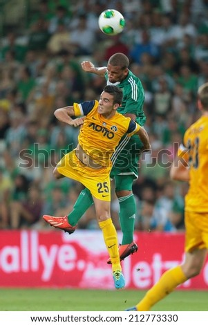 VIENNA, AUSTRIA - AUGUST 8 Terrence Boyd (#9 Rapid) and Dimitris Kourbelis (#25 Asteras) fight for the ball at a UEFA Europa League game on August 8, 2013 in Vienna, Austria. - stock photo