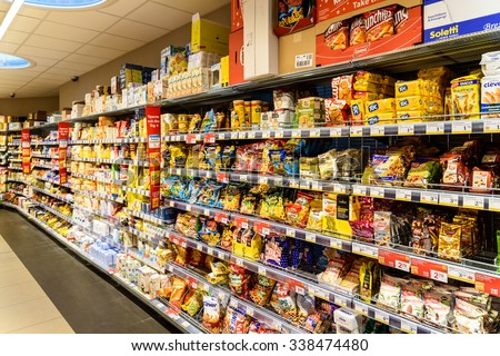 VIENNA, AUSTRIA - AUGUST 20, 2015: Unhealthy Fast Food Snacks For Sale On Supermarket Shelf.