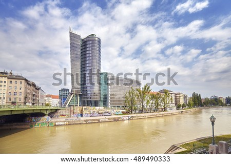 VIENNA, AUSTRIA - AUGUST 15, 2016: View of Vienna modern buildings in downtown by the Danube river.