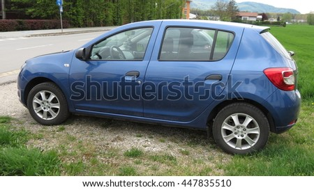 VIENNA, AUSTRIA - CIRCA APRIL 2016: light blue car parked by the street in the countryside - stock photo