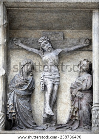 VIENNA, AUSTRIA - DECEMBER 10: Crucifixion, on the facade of the cathedral of St. Stephens, Vienna and Austria December 10, 2011
