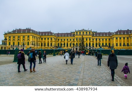 VIENNA, AUSTRIA, DECEMBER 19, 2015: People are buying various articles during a christmas market taking place in front of the schonbrunn castle in vienna.