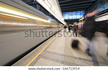 VIENNA, AUSTRIA - DECEMBER 25, 2010: Rush at Vienna subway. Vienna subway is one of the most facile way to cross the big city because of the over-crowded streets during Christmas holiday - stock photo