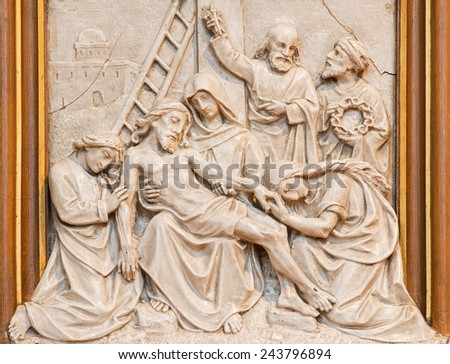 VIENNA, AUSTRIA - DECEMBER 17, 2014: The Jesus is taken down from the cross relief as one part of Cross way cycle in Sacre Coeur church by R. Haas from end of 19. cent.