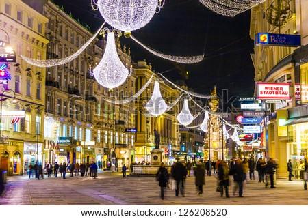 VIENNA, AUSTRIA - DECEMBER 09: Vienna - famous Graben street at night with rain reflection on the cobbles  on December 09, 2009 in Vienna, Austria. - stock photo