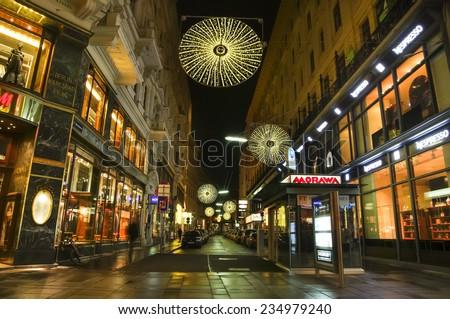 VIENNA, AUSTRIA - December 11, 2009: Vienna -  street at night with Christmas chandeliers in Vienna, Austria. on December 11, 2009 - stock photo