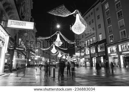 VIENNA, AUSTRIA - December 11, 2009: Vienna - tourists on famous Graben street at night with Christmas chandeliers in Vienna, Austria. on December 11, 2009. - stock photo