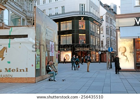 VIENNA, AUSTRIA - FEBRUARY 3,2015: City view with people and fashion shops on famous Graben street at night in Vienna, Austria. - stock photo