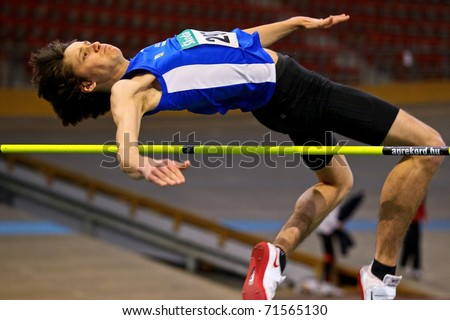 VIENNA, AUSTRIA - FEBRUARY 19: Indoor track and field championship. Alexander Dengg (#287, Austria)  places eleventh in men's high jump event on February 19, 2011 in Vienna, Austria.