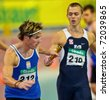 VIENNA, AUSTRIA - FEBRUARY 19: Indoor track and field championship. Manuel Prazak (#212, Austria) takes part in the men's 4x200m relay event on February 19, 2011 in Vienna, Austria. - stock photo