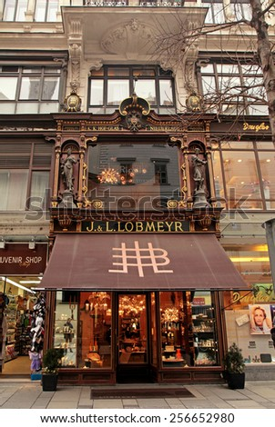 VIENNA, AUSTRIA - FEBRUARY 4, 2015: Ornate facade of Lobmeyr store in Vienna, Austria. Lobmeyr designs and sells famous luxury glass products and lighting.  - stock photo