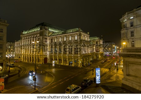 VIENNA, AUSTRIA - FEBRUARY 5, 2014: Unidentified people in front of Vienna State Opera at night. Vienna State Opera was completed in 1869 in the Neo-Renaissance style. - stock photo