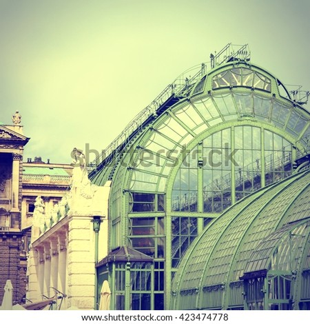 Vienna, Austria - Hofburg Palace and Butterfly Greenhouse (Schmetterlinghaus). The Old Town is a UNESCO World Heritage Site. Vintage filtered color style. - stock photo