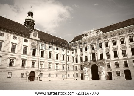 Vienna, Austria - Hofburg Palace courtyard. The Old Town is a UNESCO World Heritage Site. Sepia tone - retro monochrome color style. - stock photo