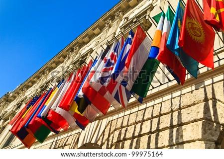 Vienna, Austria - international set of flags on Hofburg palace (OSCE headquarter) - stock photo