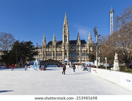 VIENNA, AUSTRIA - JANUARY 31, 2015: Ice skaters at Wiener Eistraum (ice rink) in font of the City Hall of Vienna. Every winter the Townhall square is transformed into two large ice rinks. - stock photo