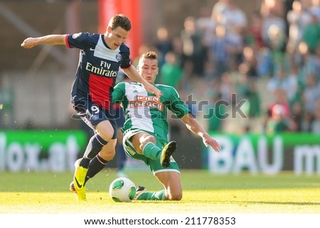 VIENNA, AUSTRIA - JULY 12 Christopher Dibon (#17 Rapid) and Kevin Gameiro (#19 Paris) fight for the ball at a friendly soccer game on July 12, 2013 in Vienna, Austria.