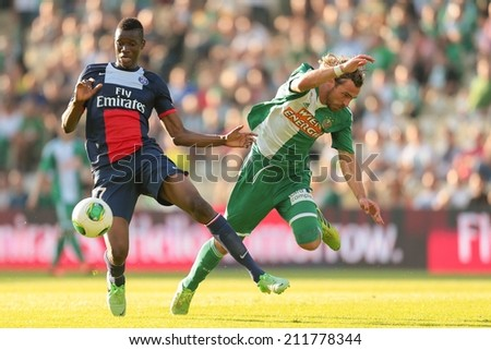 VIENNA, AUSTRIA - JULY 12 Harald Pichler (#27 Rapid) and Kalifa Coulibaly (#37 Paris) fight for the ball at a friendly soccer game on July 12, 2013 in Vienna, Austria. - stock photo