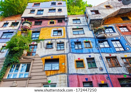 VIENNA, AUSTRIA - JULY 26: Hundertwasser Haus on July 26, 2013 in Vienna. The iconic building was finished in 1985 and is one of finest examples of expressionist architecture. - stock photo