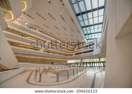 VIENNA, AUSTRIA - JULY 18, 2014: Interior of the new Vienna University of Economics and Business. It is placed near Vienna Prater and designed by famous architect Zaha Hadid. Hdr image.
