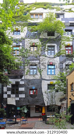 VIENNA, AUSTRIA - JULY 12: Kunst Haus Museum in Wien on JULY 12, 2015. Famous Building and Museum by Architect Hundertwasser in Vienna, Austria. - stock photo