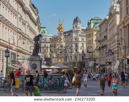 VIENNA, AUSTRIA - JULY 16: People is walking in Graben street (Grabenstrasse), main street in old town of Vienna. The column, called The Pests���¤ule (Plague column) was built in 1693 after epidemics.  - stock photo