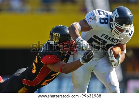 VIENNA, AUSTRIA - JULY 16 RB Laurent Marceline   (#28 France) is tackled at the Football World Championship on July 16, 2011 in Vienna, Austria. - stock photo