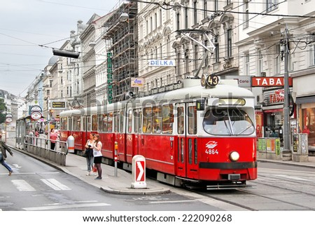 VIENNA, AUSTRIA - JULY 22, 2014: Red vintage tramway SGP Type E1 at the city street. - stock photo