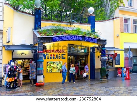 VIENNA, AUSTRIA - JULY 31, 2014: Tourists near famous Hundertwasser village in Vienna, Austria.  Friedensreich Hundertwasser was an Austrian artist.  - stock photo