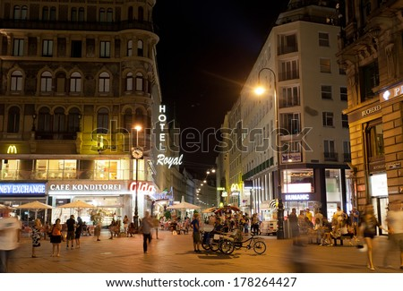 VIENNA, AUSTRIA - JULY 27,2013. Tourists walk at night in center of Vienna, Austria, July 26,2013. population of Vienna makes 1,68 million people, Vienna is largest on population the city of Austria