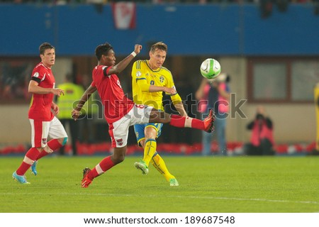 VIENNA,  AUSTRIA - JUNE  7 David Alaba (#8 Austria), and Kim Kaellstroem (#9 Sweden) fight for the ball during the world cup qualifier game on June 7, 2013 in Vienna, Austria. - stock photo
