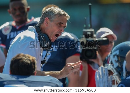 VIENNA, AUSTRIA - JUNE 7, 2014: Head Coach Larry Legault (France) speaks to his team during the game against Finland.
