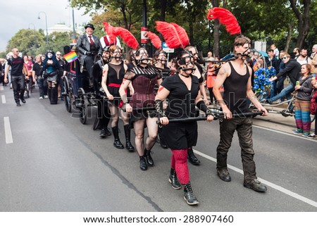Vienna, Austria - June 20, 2015: Lesbian, gay and transgender people celebrate their importent event on the Ringstrasse of Vienna for solidarity, acceptance and equality. - stock photo