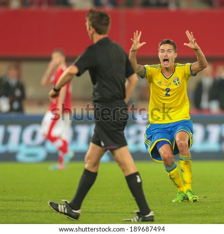 VIENNA,  AUSTRIA - JUNE  7 Mikael Lustig (#2 Sweden), complains to Referee Gianluca Rocchi (Italy) during the world cup qualifier game on June 7, 2013 in Vienna, Austria. - stock photo